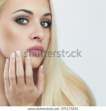 Young blond woman.Beautiful Girl.close-up fashion portrait isolated on white background.french manicure - stock photo