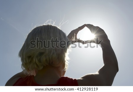 young blond woman catching sun - stock photo