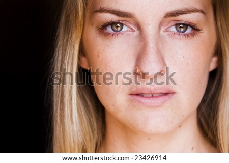 Young blond woman close portrait - stock photo