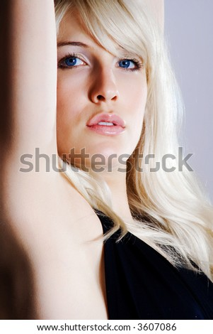 young blond woman close up portrait - stock photo