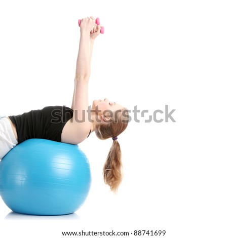 Young blond woman exercising, isolated on white background