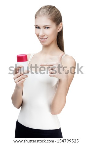 young blond woman holding antiperspirant isolated on white