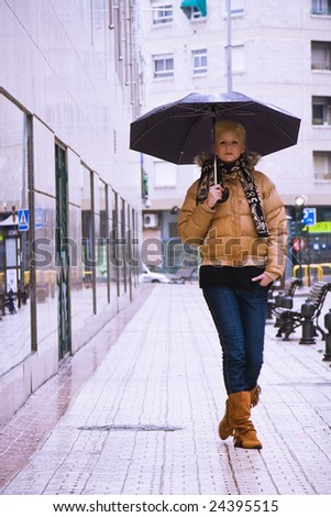 Young blond woman in a rainy day. - stock photo