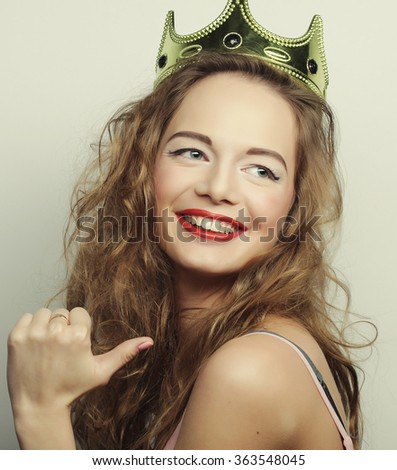 young blond woman in crown  - stock photo