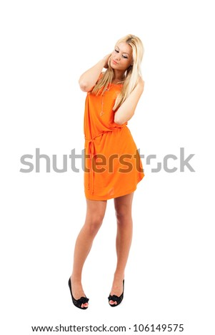 Young blond woman in orange dress over white background