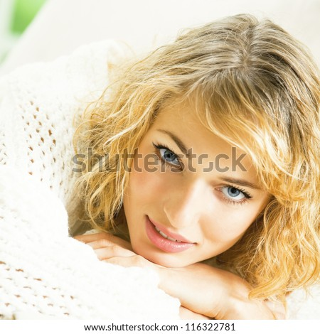 Young blond woman in scarf at home - stock photo