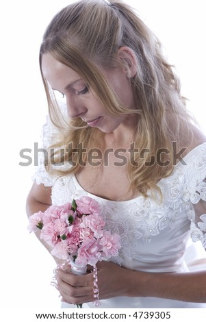 Young blond woman in wedding dress