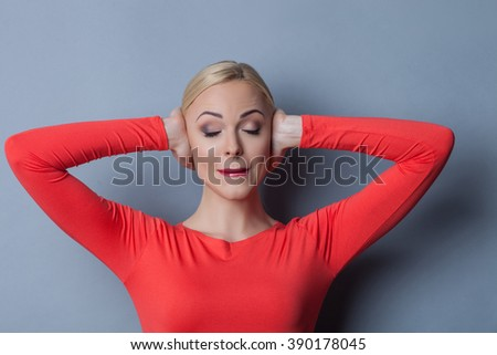 Young blond woman is has pain in her head - stock photo