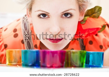 Young blond woman portrait, staring at camera. - stock photo