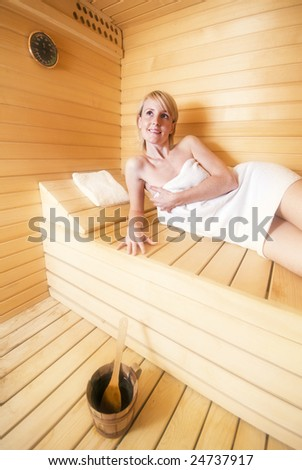 young blond woman relaxing in sauna close up