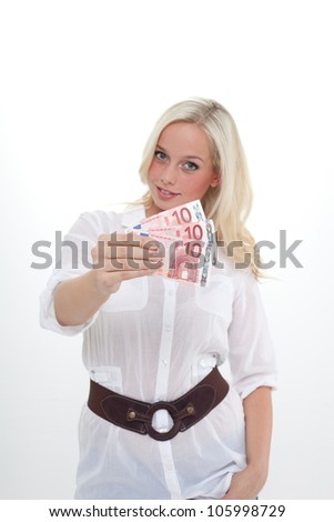 young blond woman shows three tenner euro banknotes/young blond woman holds  euro banknotes in her hand/woman shows banknotes