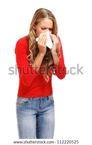 young blond woman sneezes isolated on white - stock photo