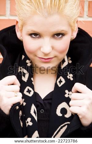 Young blond woman staring at camera. - stock photo