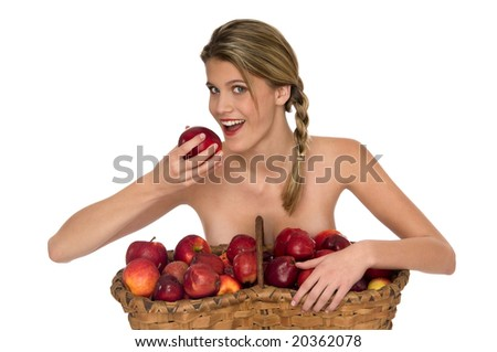 Young blond woman taking a bite of a red apple isolated on white background