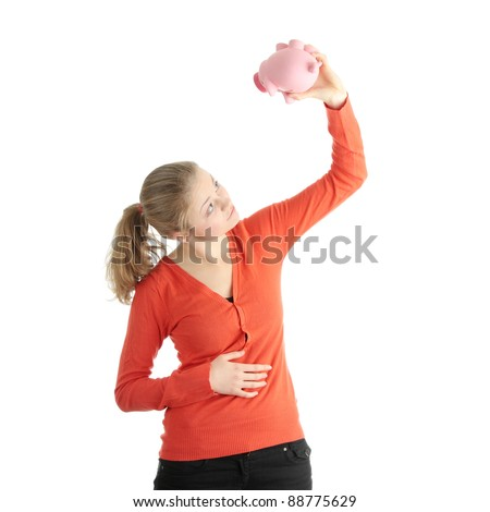 Young blond woman trying to get money from her piggy bank, isolated on white background - stock photo