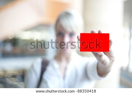 young blond woman with an identification card/woman with identification card - stock photo