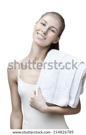 young blond woman with bathtowel isolated on white - stock photo