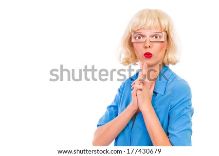 Young blond woman with fake eyes showing finger gun. Waist up studio shot isolated on white. - stock photo