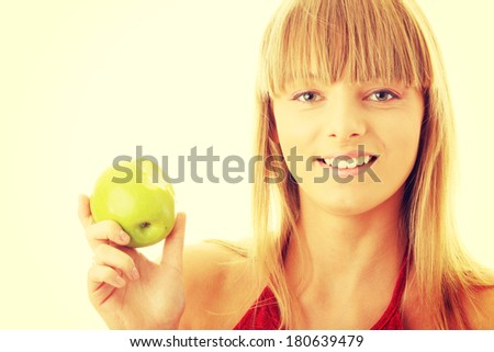 Young blond woman with green apple isolated on white background - healthy concept - stock photo