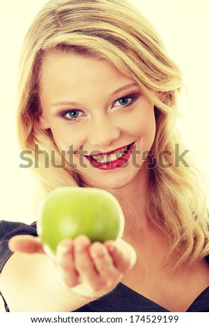 Young blond woman with green apple on her hand - healthy eating concept - stock photo