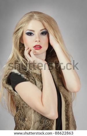 Young blond woman with hands in hair