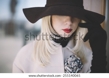 young blond woman with hat  - stock photo