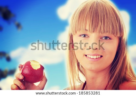 Young blond woman with red apple - healthy concept - stock photo