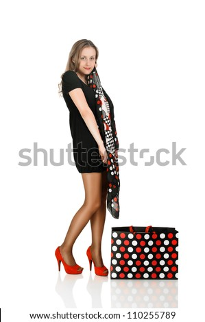 young blond woman with shop bag on white - stock photo