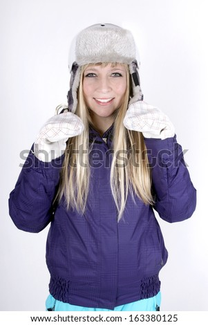 Young blond woman with skiing suit and helmet - stock photo