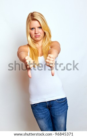 young blond woman with thumbs down - stock photo