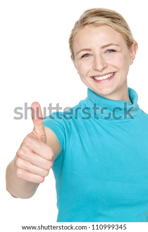 young blond woman with thumbs up for success - stock photo