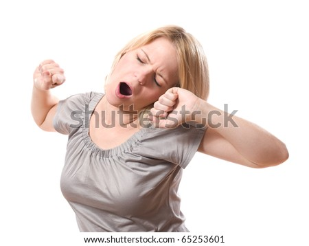 young blond woman yawning isolated on white background - stock photo
