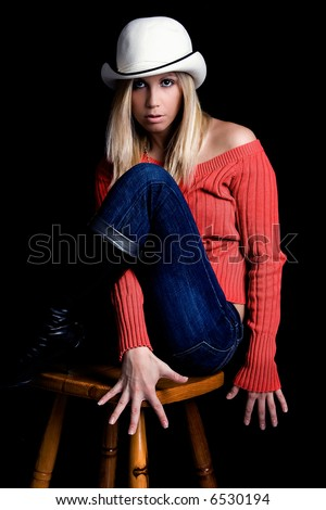 young blond women with hat, studio shot - stock photo