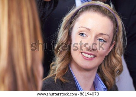 Young blonde attractive businesswoman, smile to her colleague - stock photo