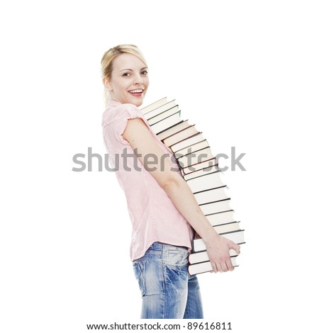 young blonde attractive woman holding a pile of books