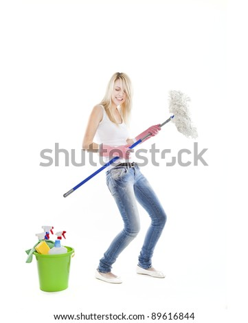 young blonde attractive woman with tools for housecleaning - stock photo