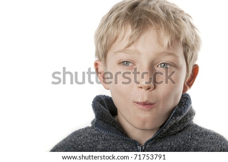young blonde boy eating chocolate