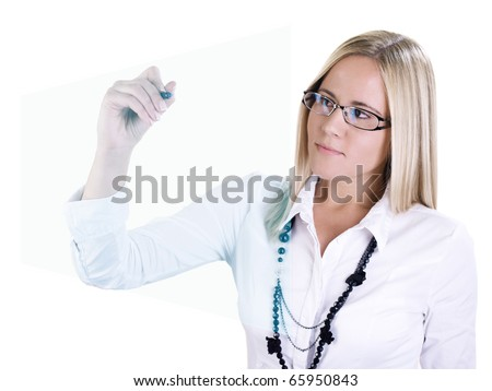 Young blonde business woman drawing on a virtual graph - stock photo