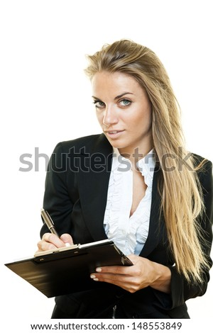 Young blonde business woman writing on a notepad