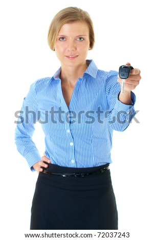 young blonde businesswoman in blue shirt gives car key, studio shoot isolated on white - stock photo