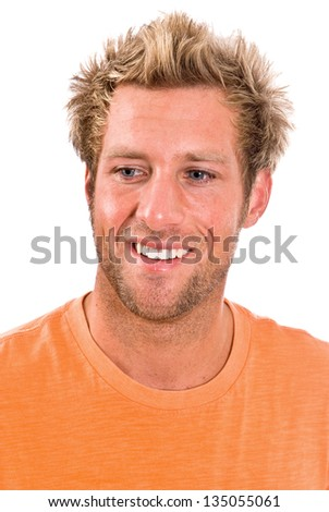 Young blonde Caucasian male in a bright orange t-shirt - stock photo