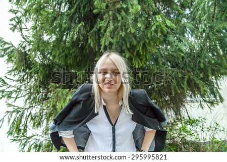 Young blonde dressed in casual office style