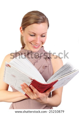 young blonde female holding a book or photo album and smiling (isolated on white)
