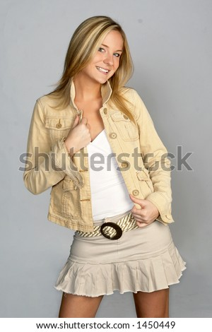 Young Blonde Female in Hip Outfit - stock photo