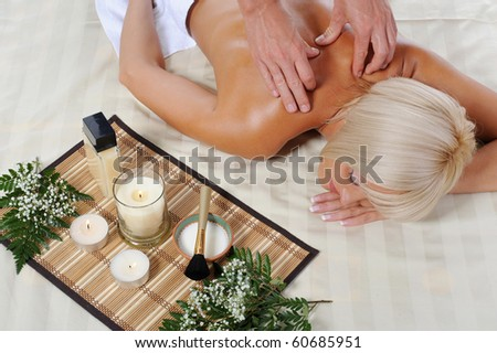 young blonde for massage in the spa salon