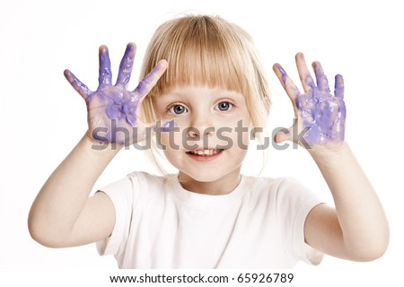 Young blonde girl child finger painting - stock photo
