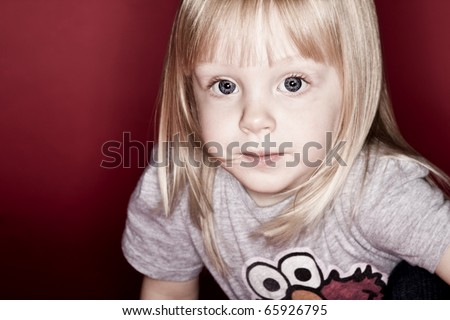 Young blonde girl child portrait - stock photo