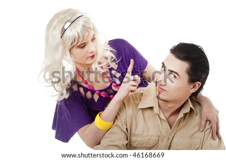 Young blonde girl drawing attention of her boyfriend - stock photo