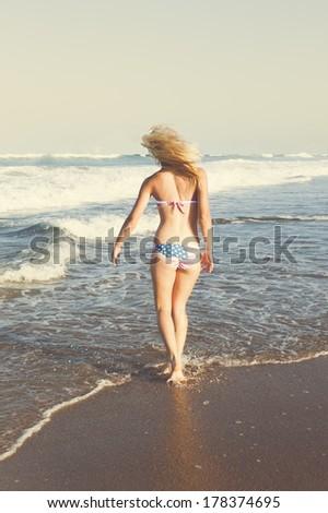 young blonde girl enjoying the beach - stock photo