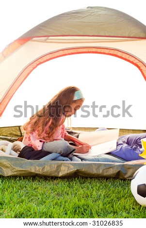 Young blonde girl in tent - stock photo